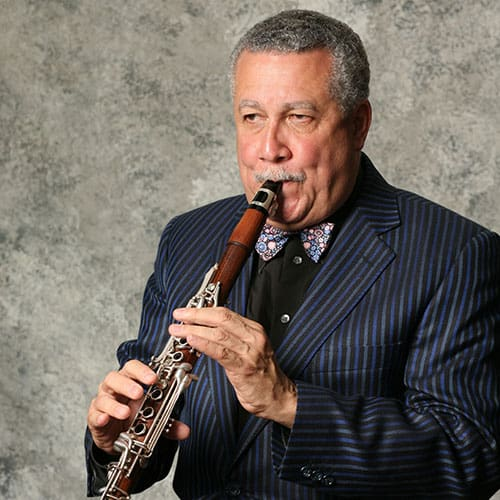 Paquito portrait photo playing clarinet