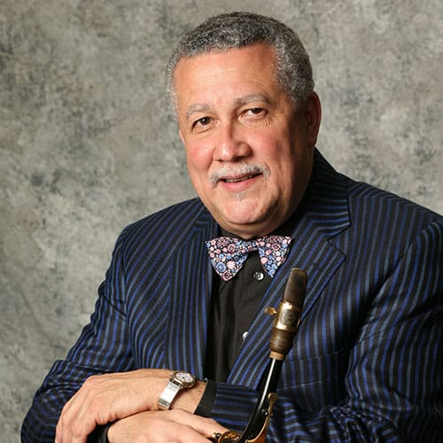 Paquito portrait photo holding saxophone