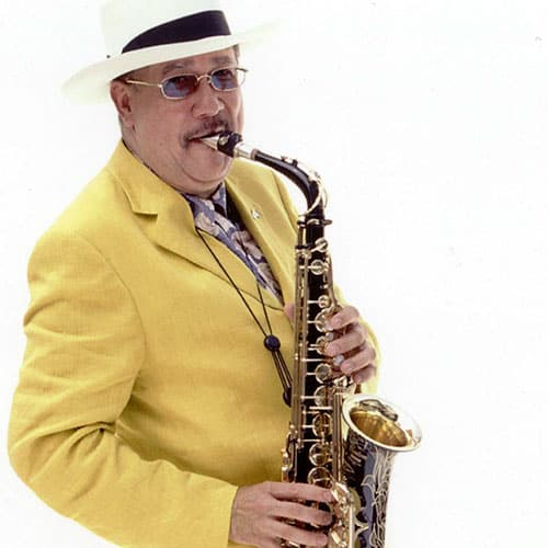 Paquito in Yellow Jacket Playing Sax