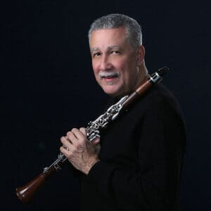 Paquito Portrait Holding Clarinet Black Backdrop