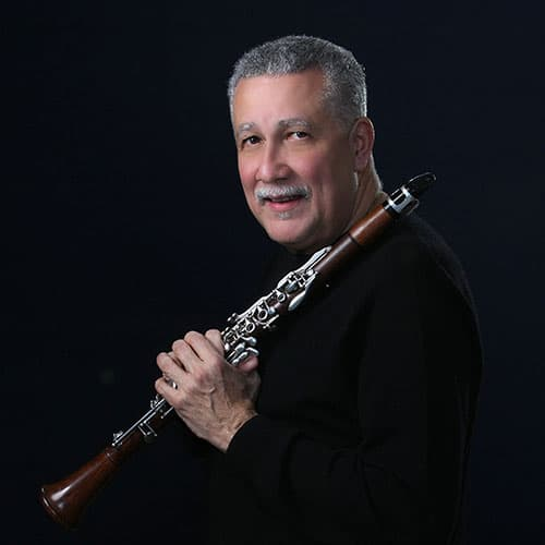 Paquito Portrait Holding Clarinet Black Backdrop