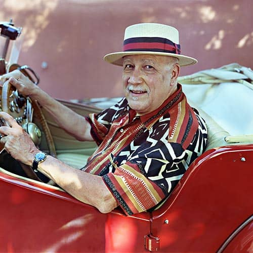 Paquito in Red Convertible with Panama Hat