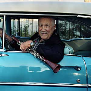 Paquito in Blue Car With Clarinet