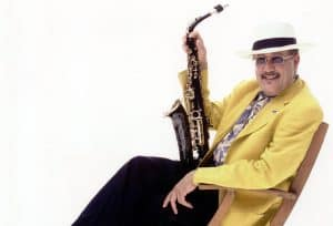 Paquito in Yellow Jacket with Saxophone for June 16 concert