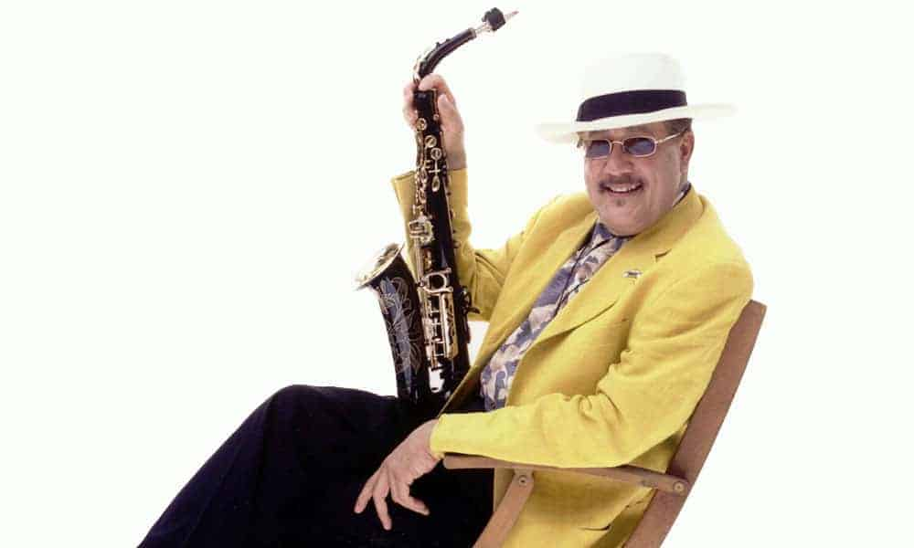 Paquito D'Rivera yellow jacket with saxophone